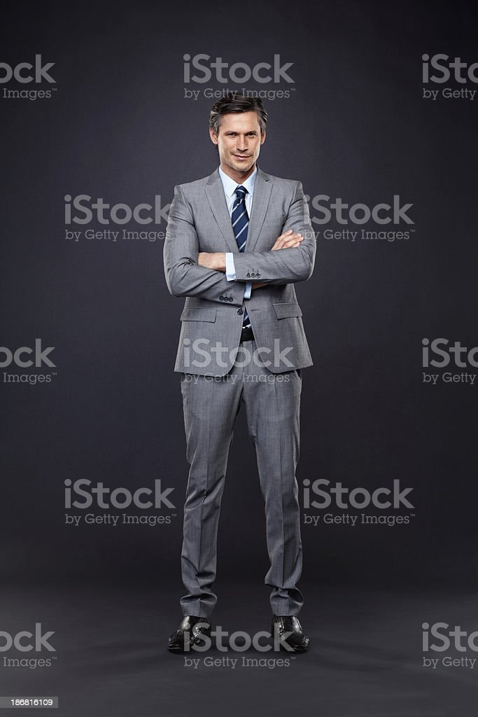 Serious executive with arms crossed royalty-free stock photo