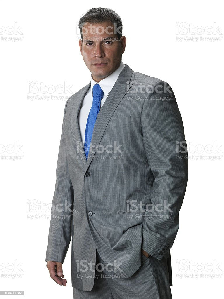 Serious executive with his hands in pockets royalty-free stock photo