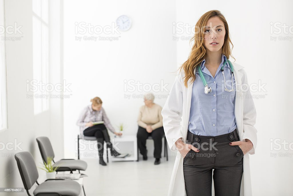 Serious Female Doctor in a hospital corridor. royalty-free stock photo
