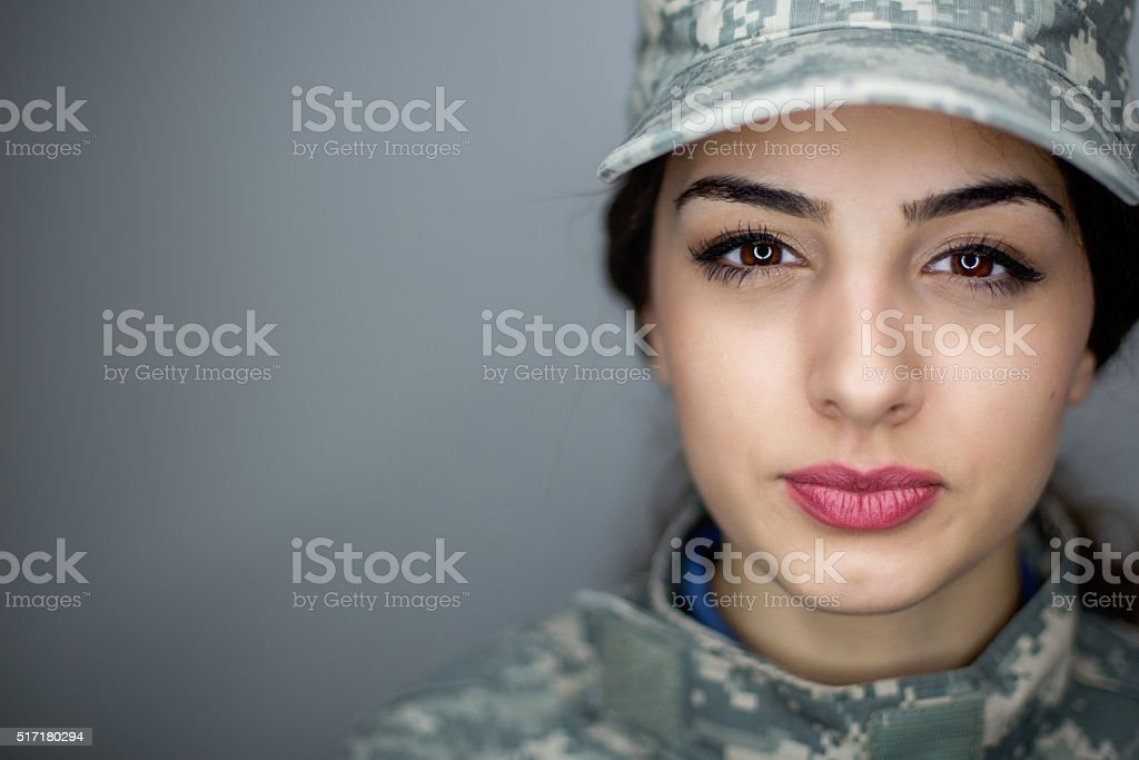 Serious female soldier stock photo