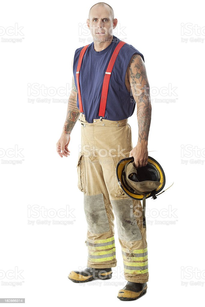Serious firemam full body portrait with tattoos stock for Working man tattoo