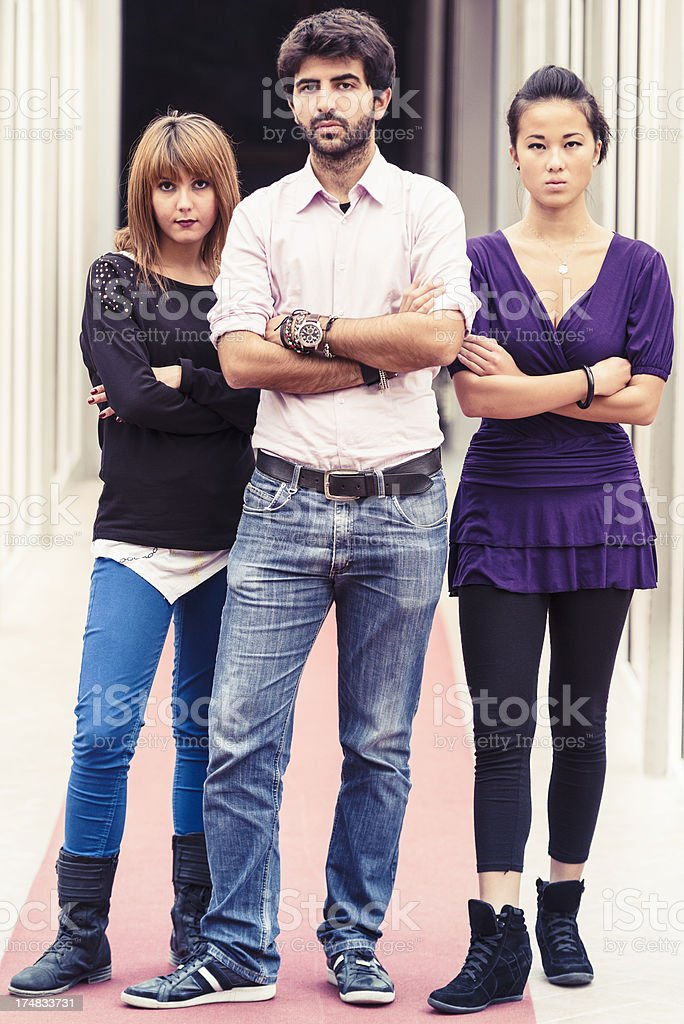 Serious friends standing with arm crossed royalty-free stock photo