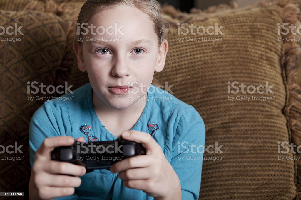 Serious Girl Playing Video Games royalty-free stock photo