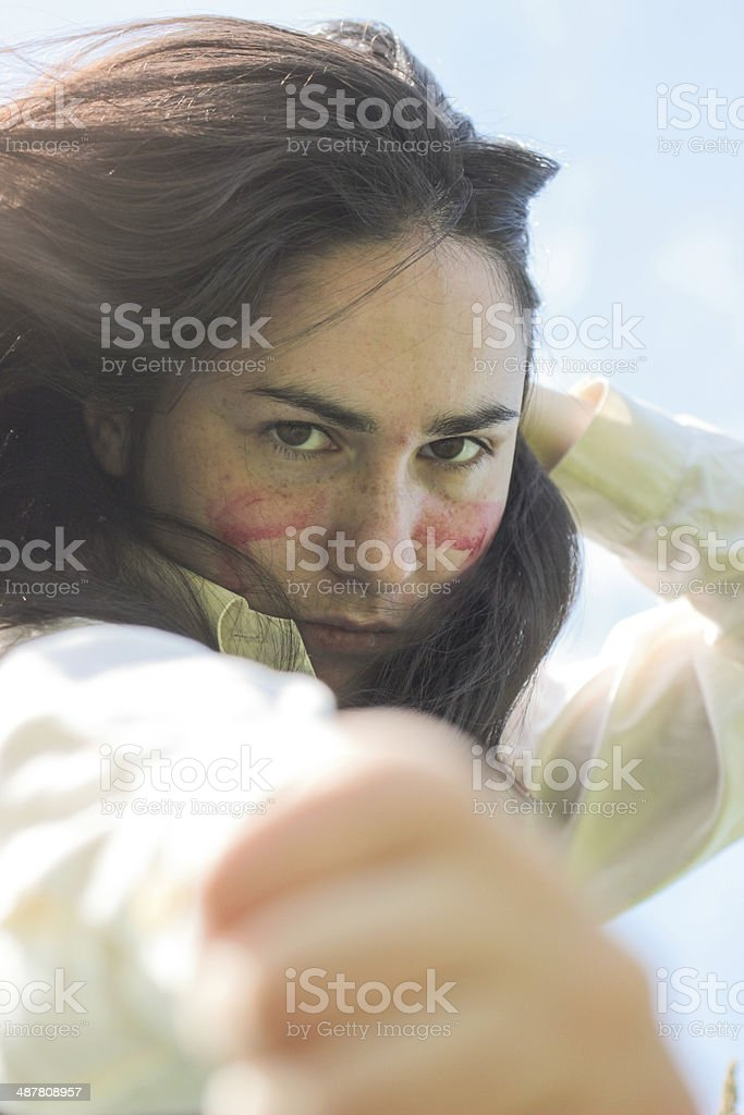 Serious Girl with red stripes on Face stock photo