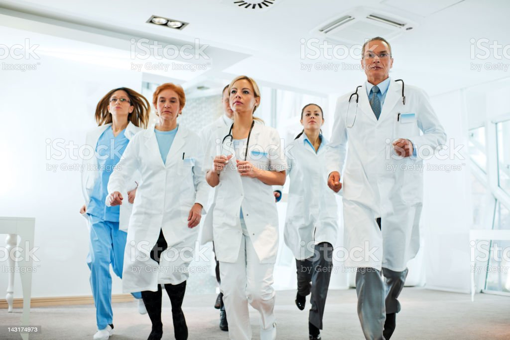 Serious group of doctors running royalty-free stock photo