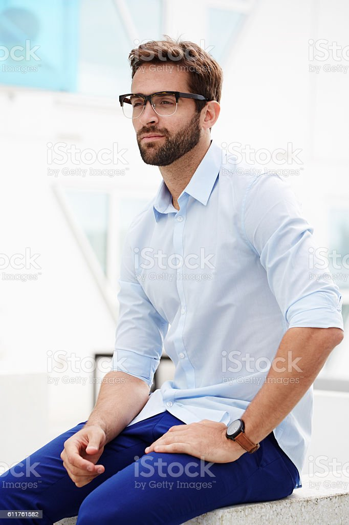 Serious guy in blue stock photo