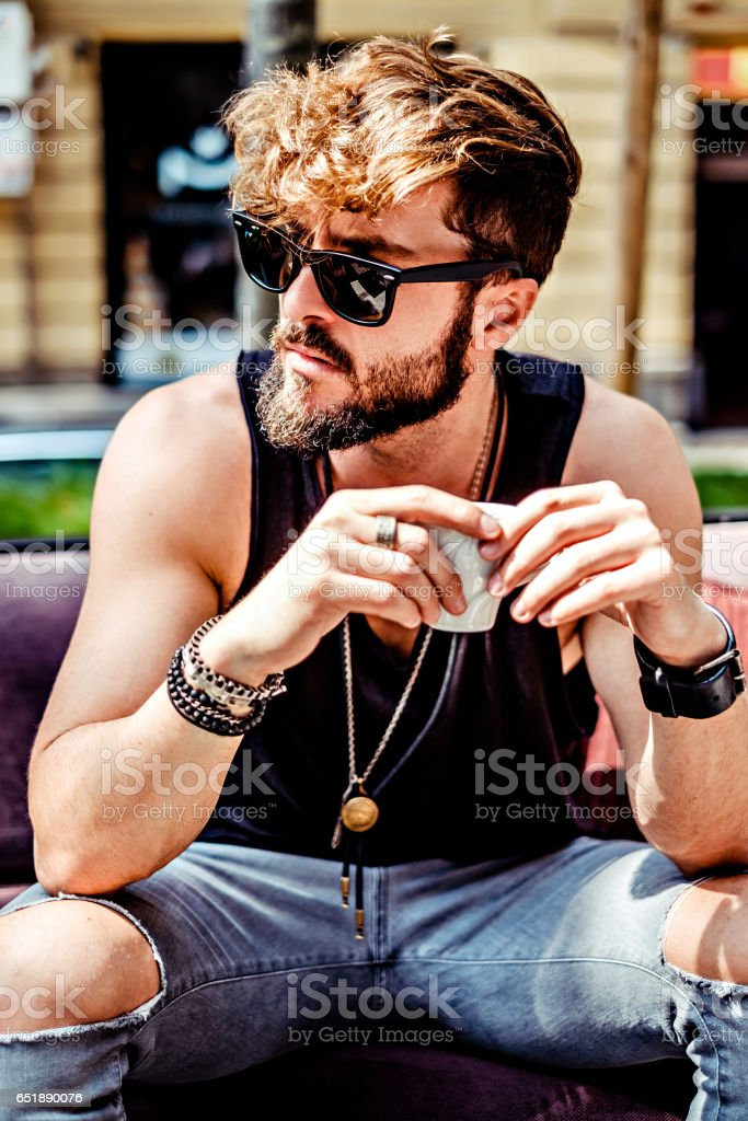 Serious hipster man drinking espresso stock photo