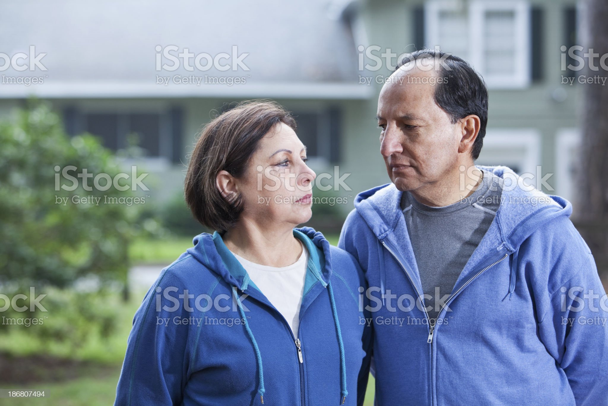 Serious Hispanic couple outside house royalty-free stock photo