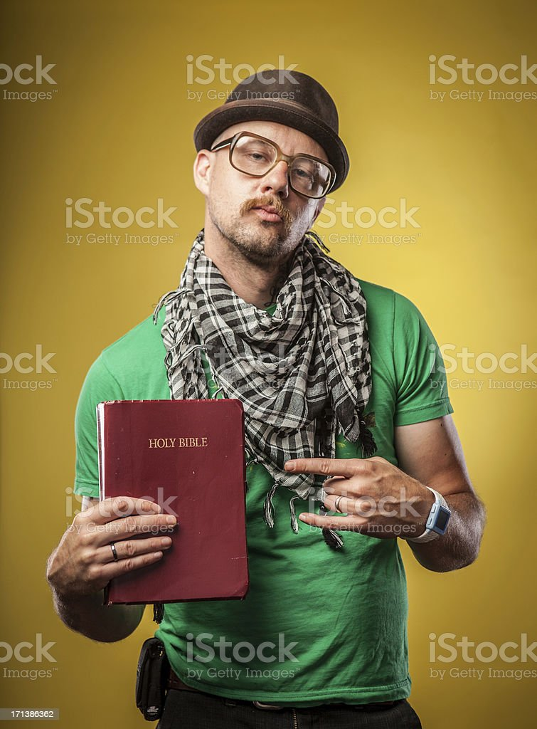 Serious Holy Christain Hipster Bible Holding Man Pointing at Book royalty-free stock photo