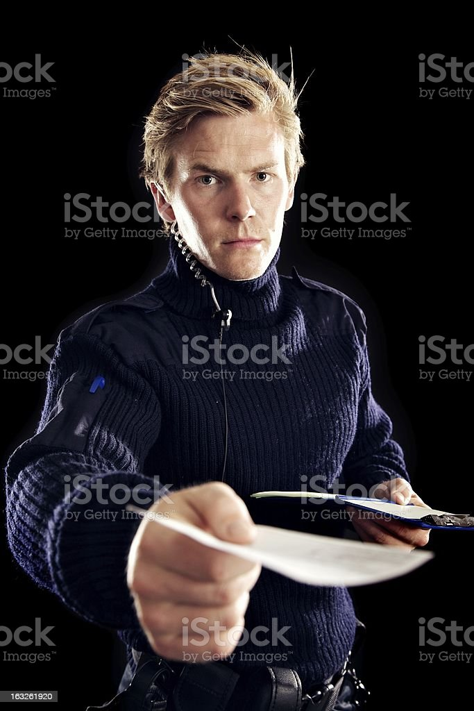 Serious Inspector with a Note in His Hand royalty-free stock photo