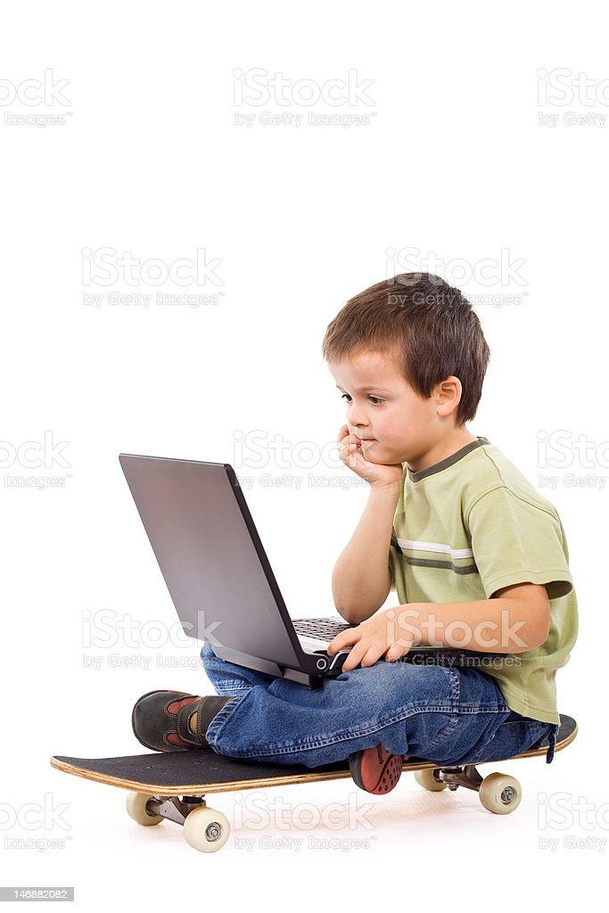 Serious kid mobile computing royalty-free stock photo