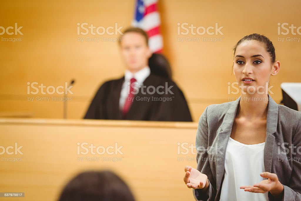 Serious lawyer make a closing statement stock photo