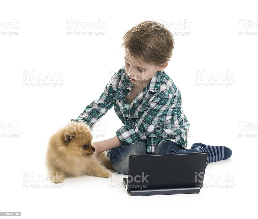 Serious little boy and his dog royalty-free stock photo