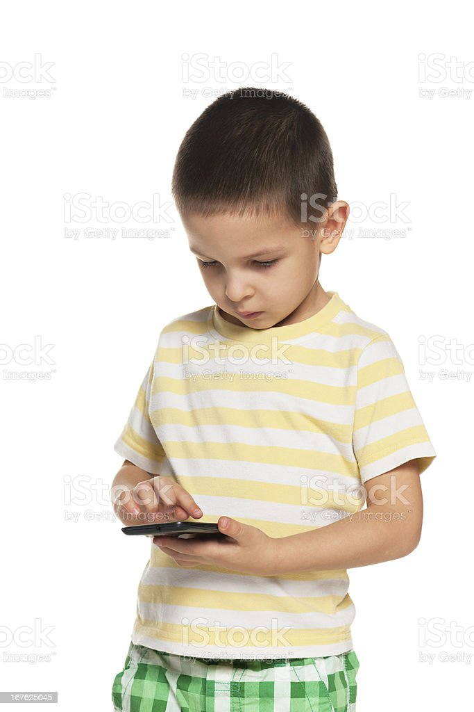 Serious little boy with a smartphone royalty-free stock photo