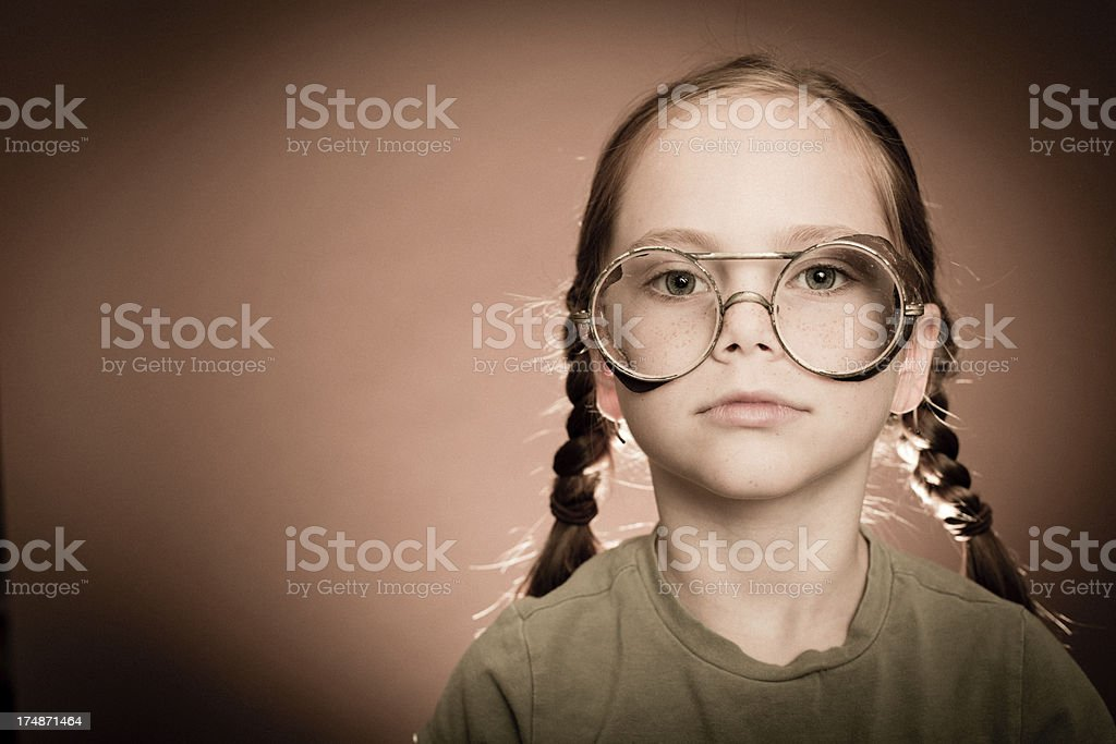 Serious Little Girl Wearing Steampunk Eyeglasses royalty-free stock photo