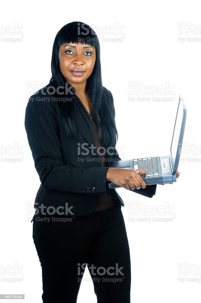 Serious Looking African American Businesswoman Holding A Laptop stock photo