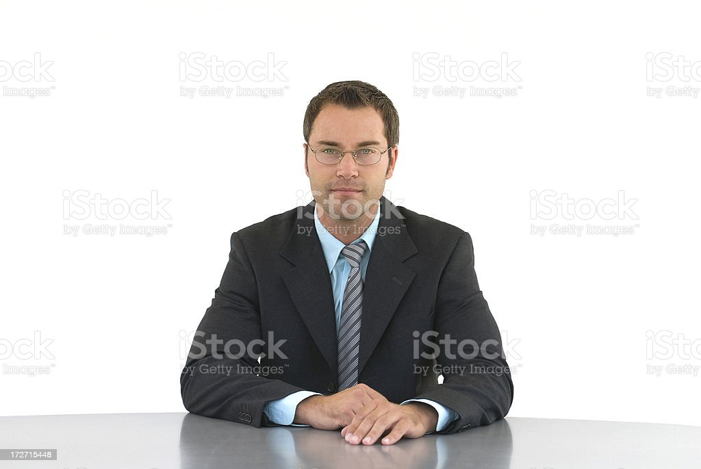 A serious looking business man on a white background. royalty-free stock photo