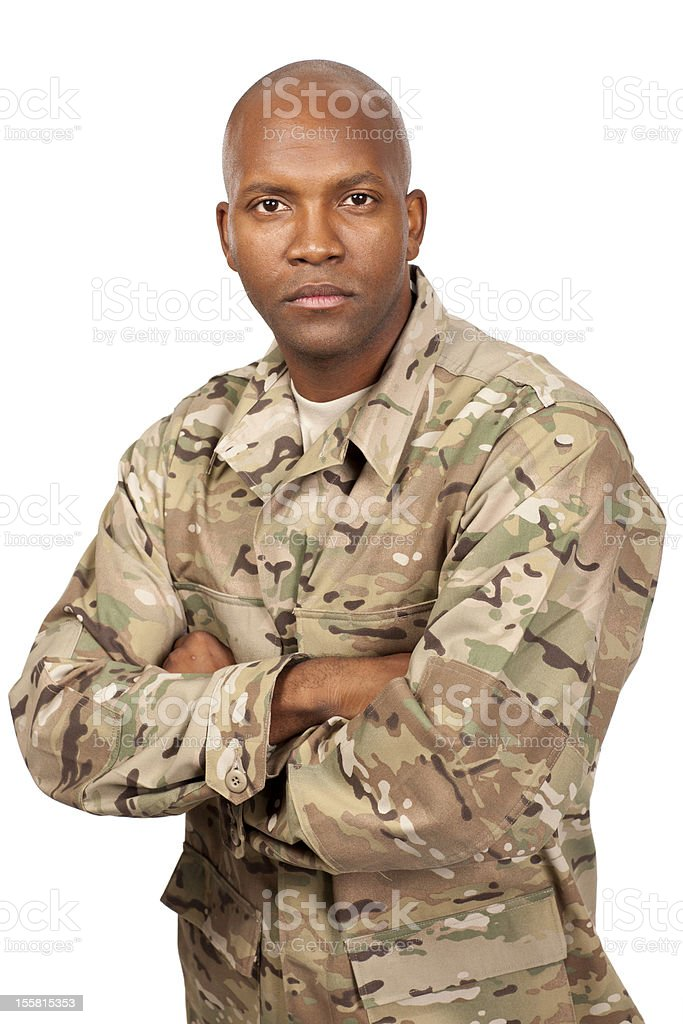 Serious looking serviceman with his arms crossed royalty-free stock photo