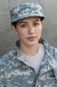 Serious looking servicewoman with blank expression