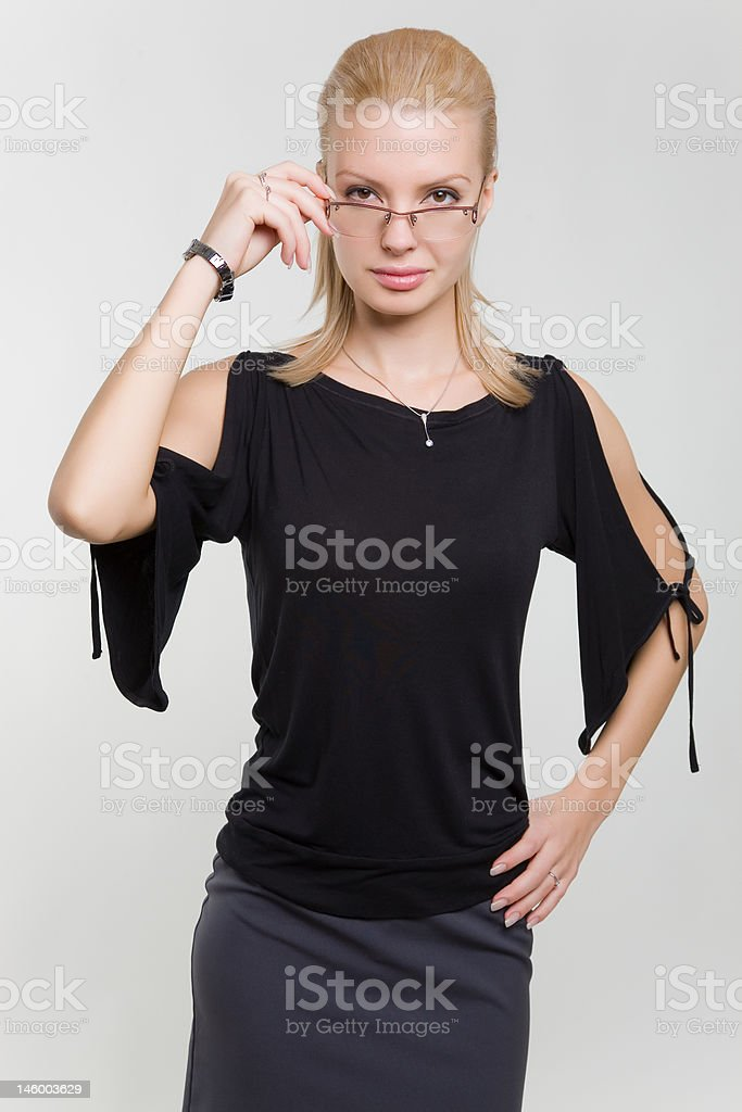Serious looking woman in glasses royalty-free stock photo