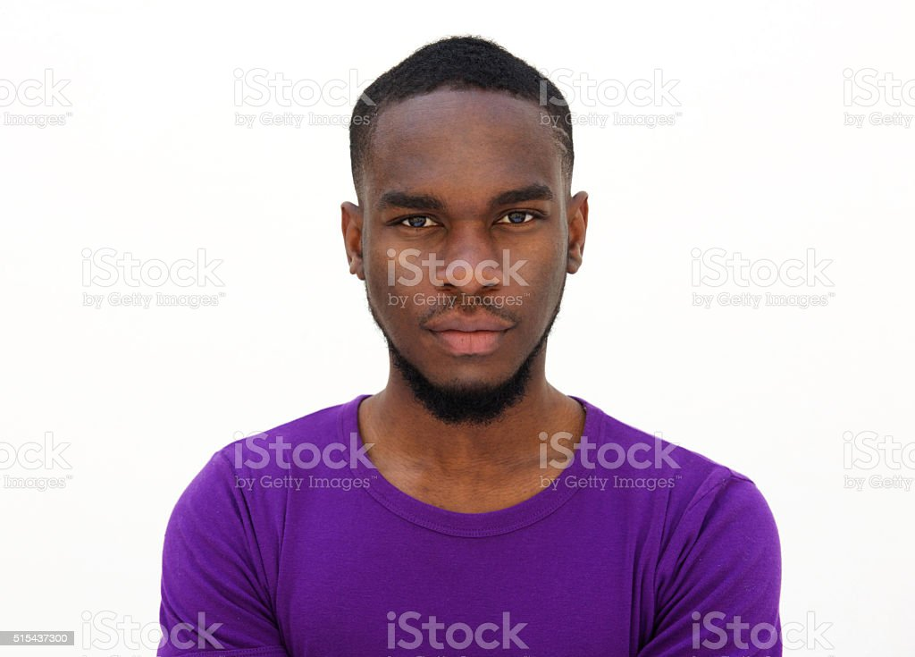 Serious looking young african man stock photo