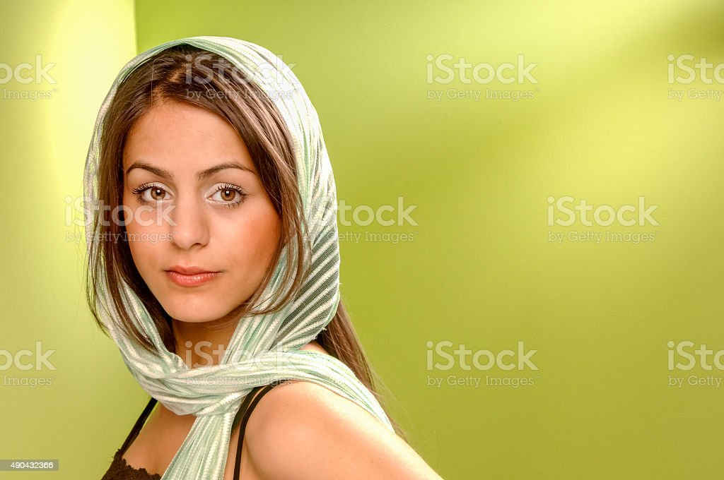 serious looking young woman in veil stock photo