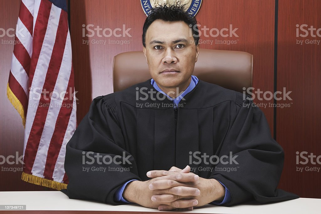 Serious Male Judge in Courtroom stock photo