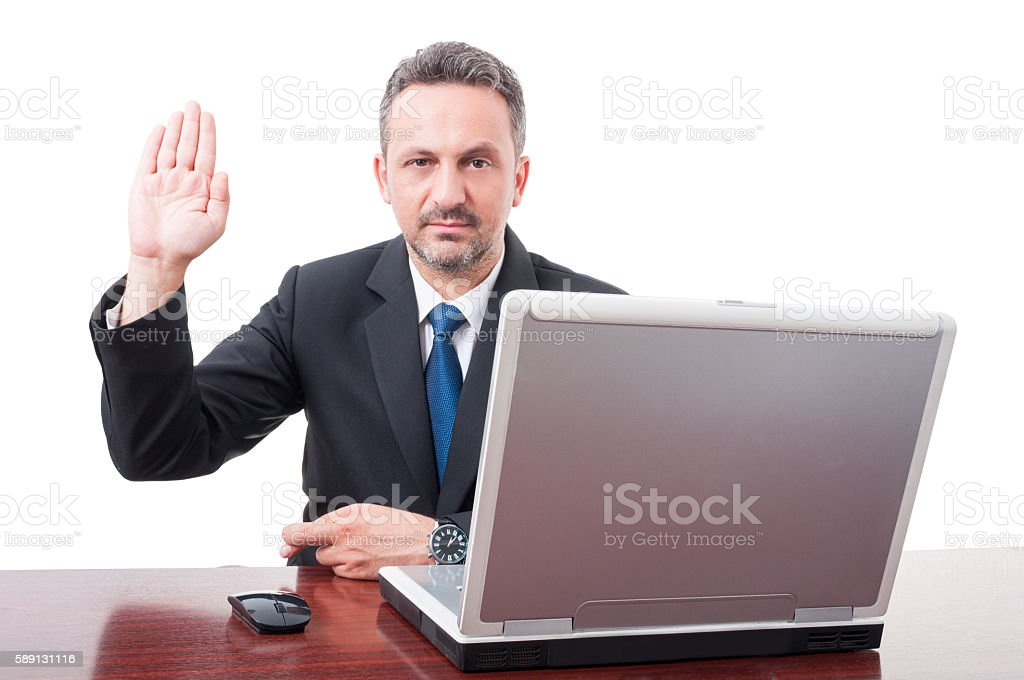 Serious male manager doing a false testimony stock photo