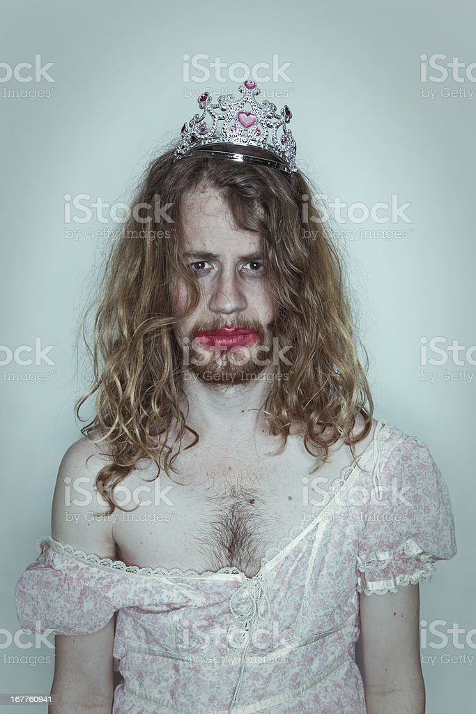 Serious Male Prom queen in drag tiara on head lipstick stock photo