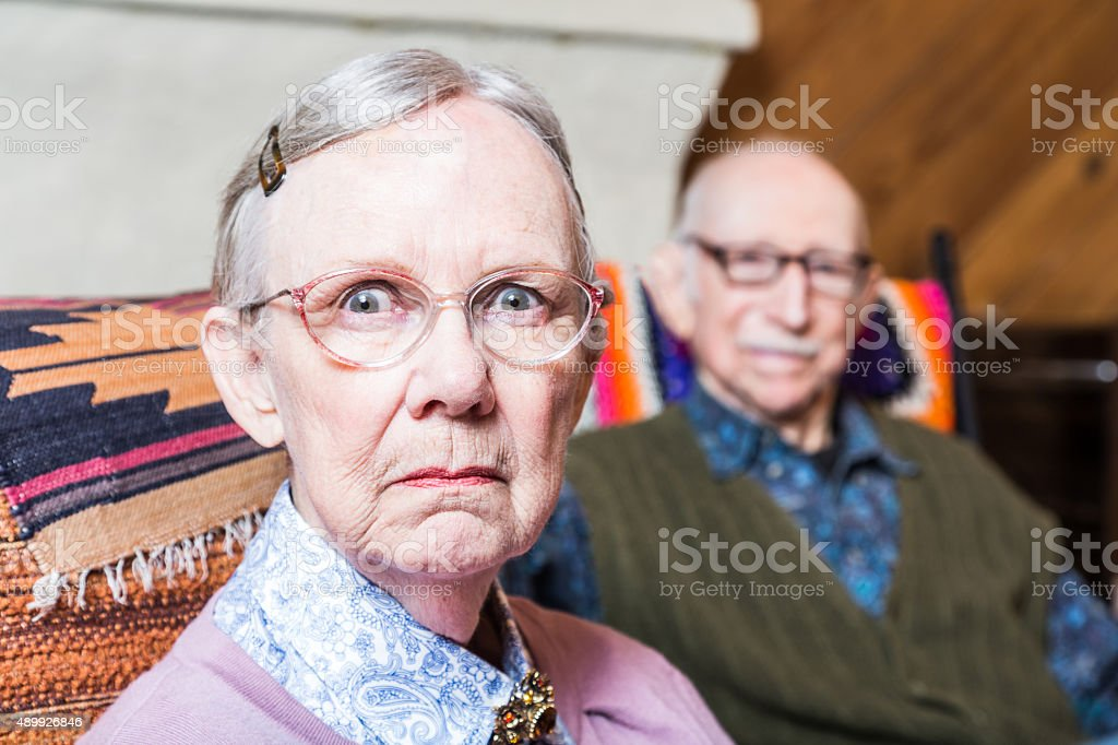 Serious Man and Woman Indoors stock photo