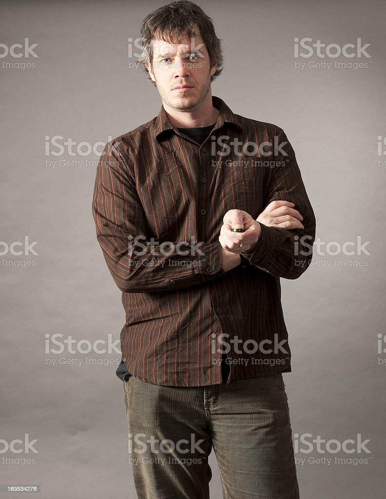serious man autoportrait with remote royalty-free stock photo