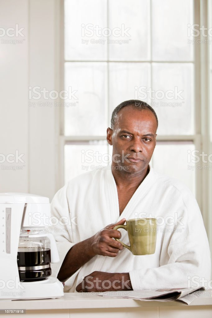 Serious Man Drinking Coffee royalty-free stock photo