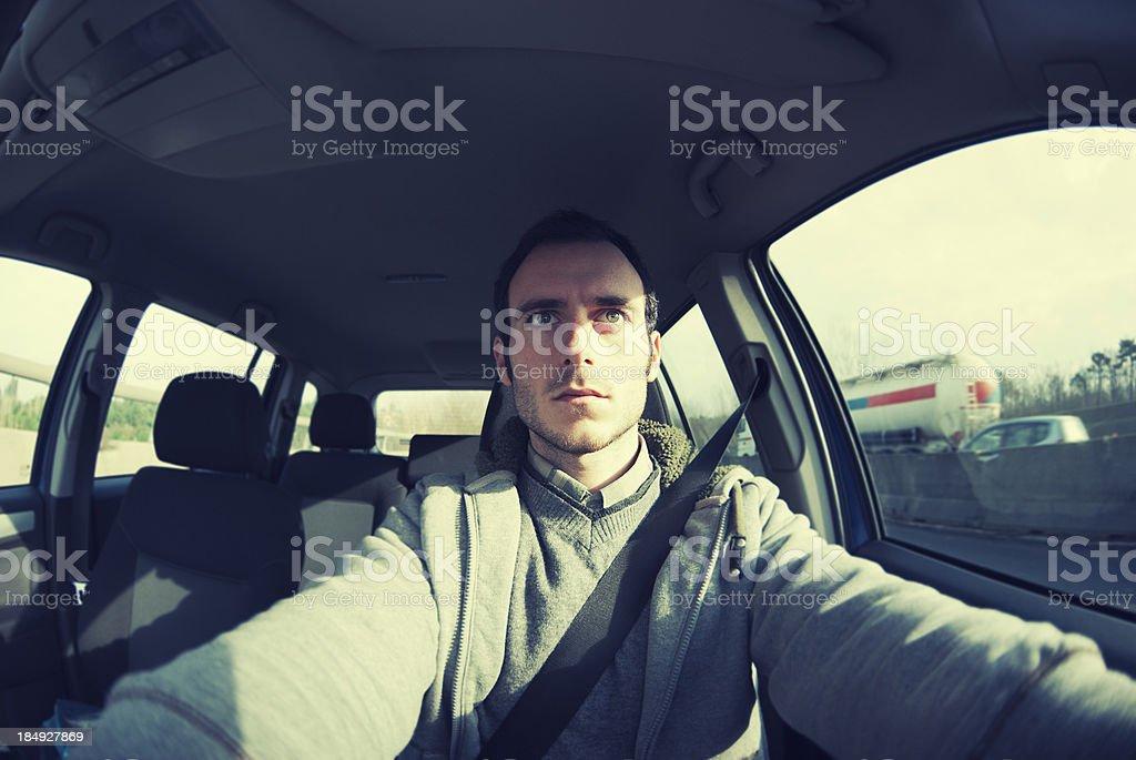 Serious man driving his car royalty-free stock photo