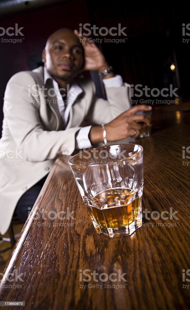 Serious man having a drink royalty-free stock photo