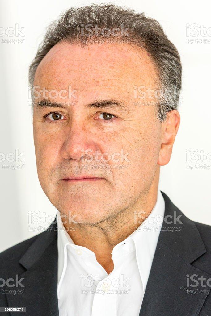 Serious man headshot stock photo