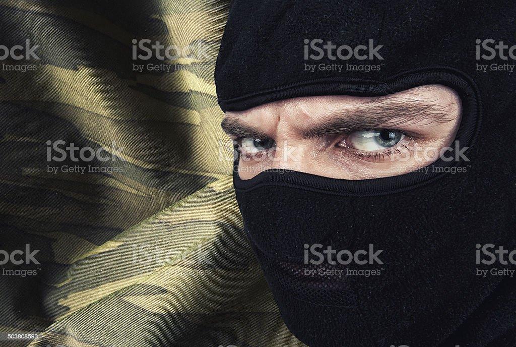 Serious man in a balaclava mask stock photo