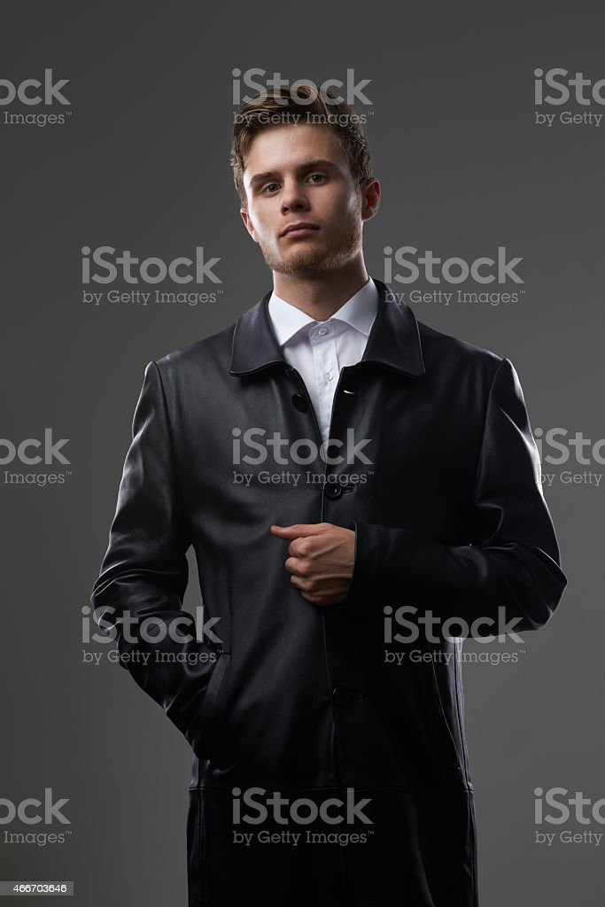 serious man in a leather coat stock photo