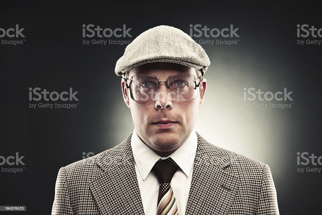 Serious man in retro suit royalty-free stock photo