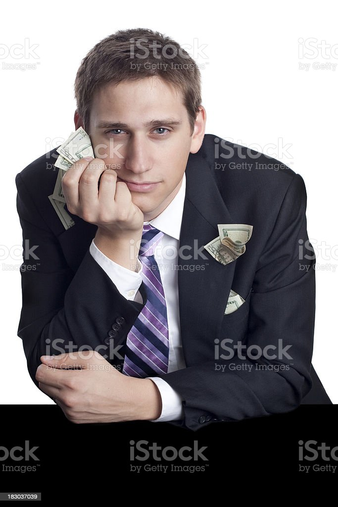 Serious Man in Suit and Tie Holding Money royalty-free stock photo