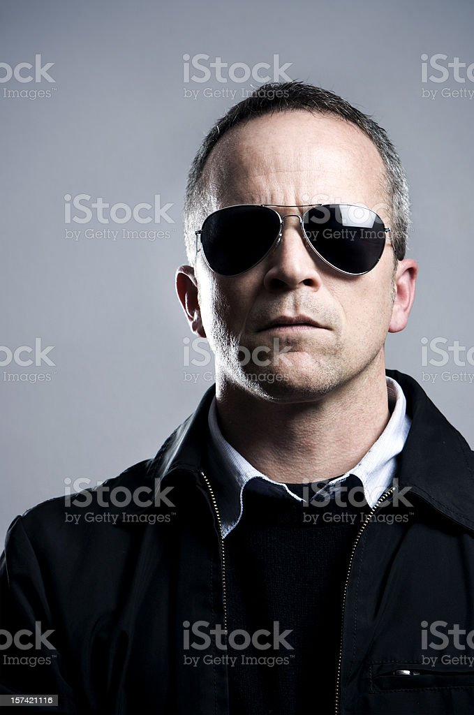 Serious Man in Sunglasses stock photo