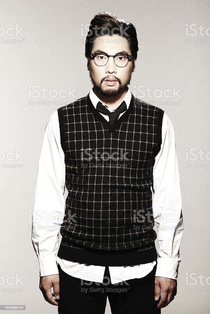 Serious Man in Sweater Vest with eyeglasses royalty-free stock photo