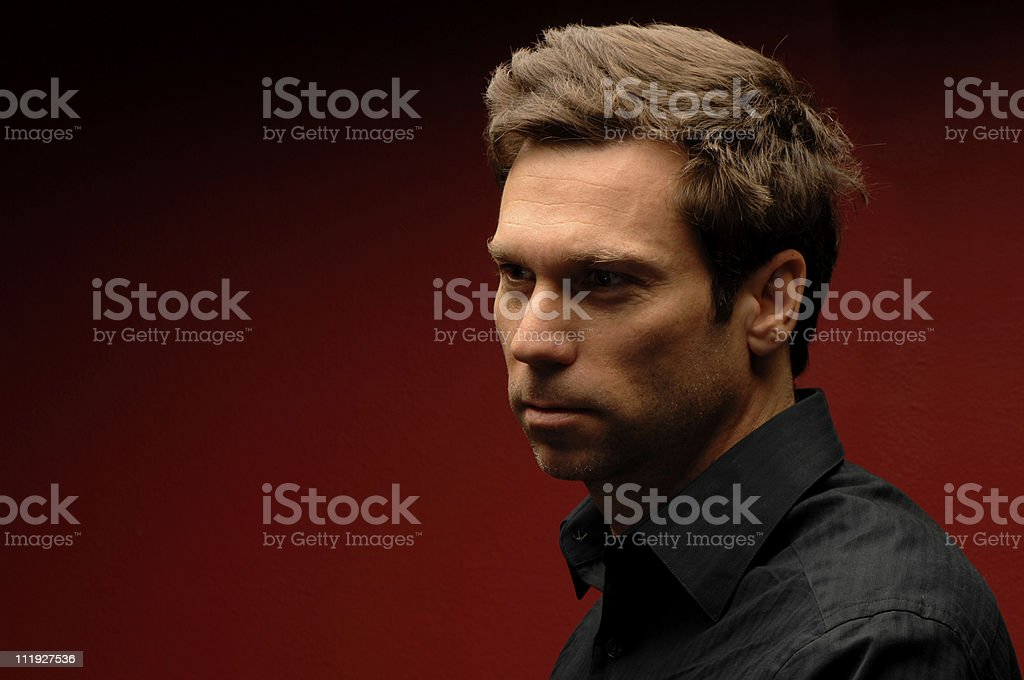 Serious Man on Red Background royalty-free stock photo