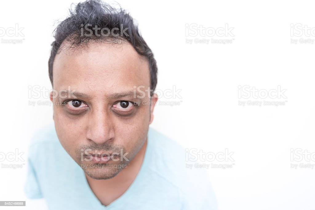 Serious Man Pursing His Lips Together stock photo