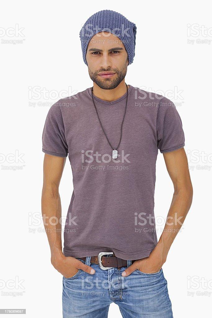 Serious man wearing beanie hat stock photo