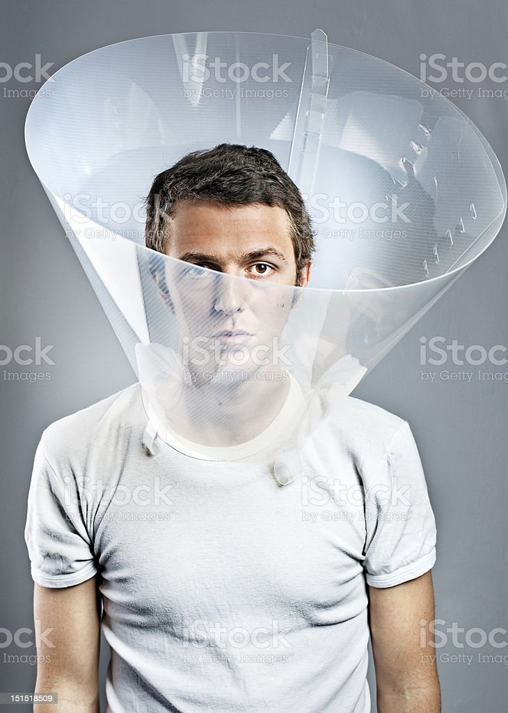 Serious Man Wearing Dog Cone stock photo