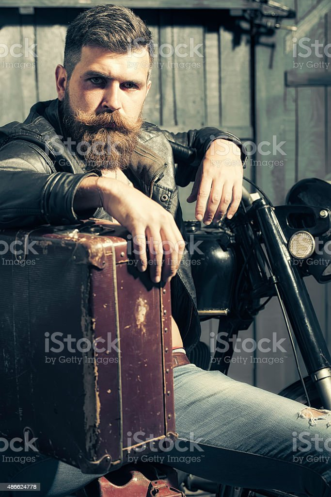 Serious man with briefcase stock photo