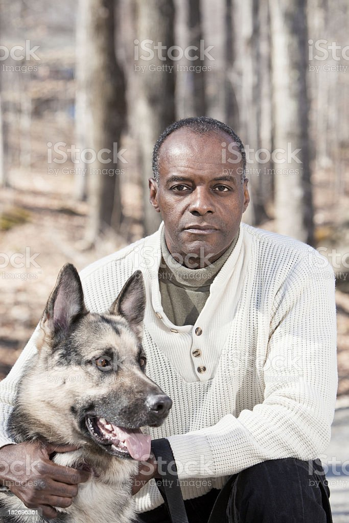 Serious Man with Ddog royalty-free stock photo