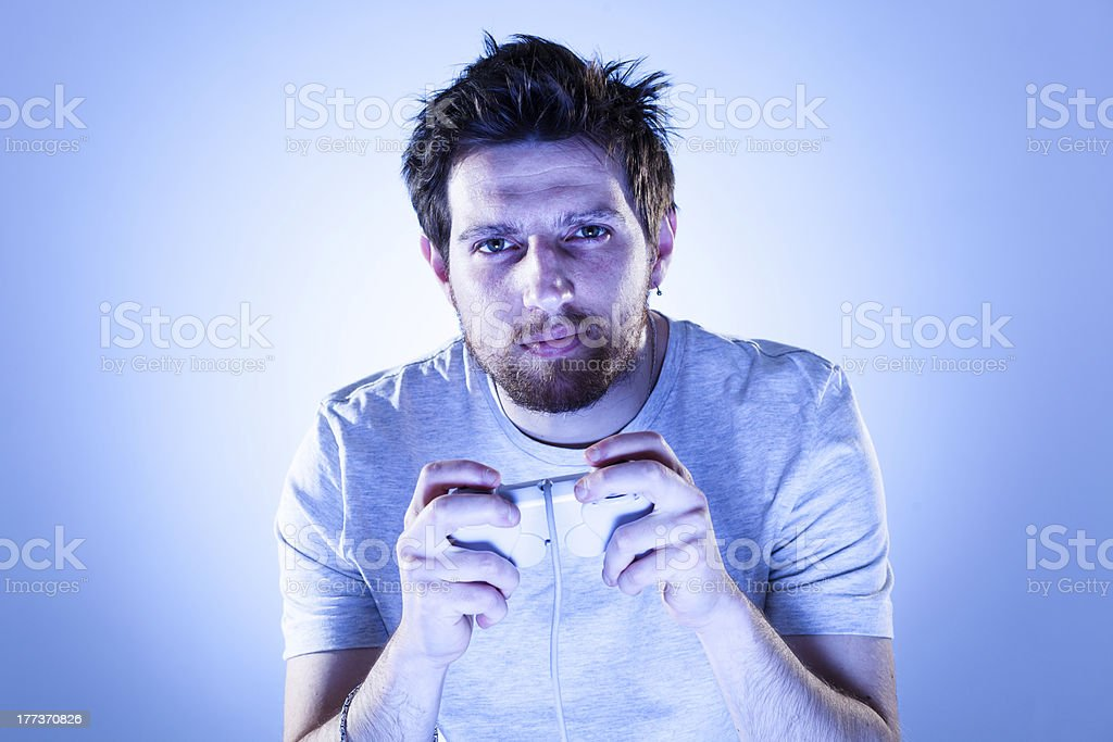 Serious Man with Gamepad royalty-free stock photo