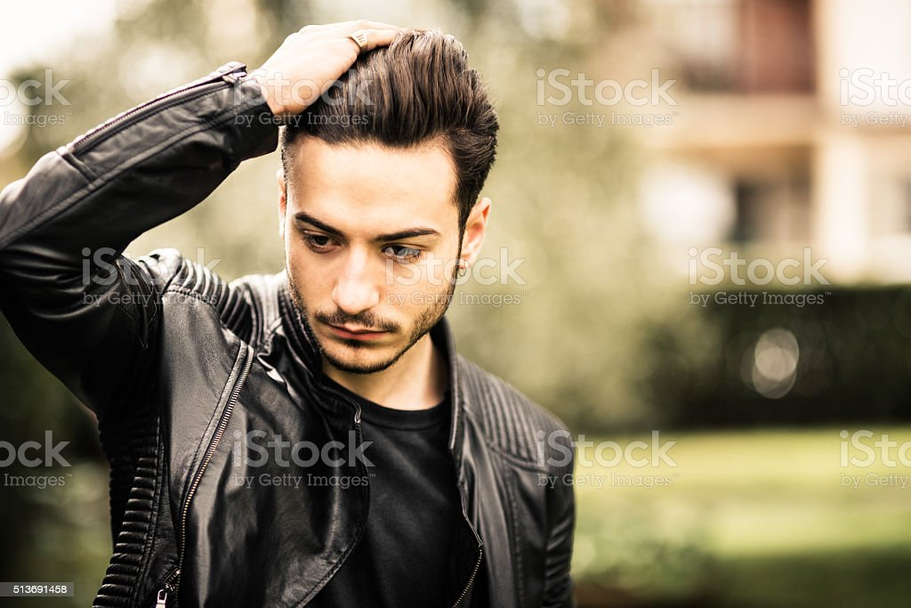 Serious man with leather jacket stock photo