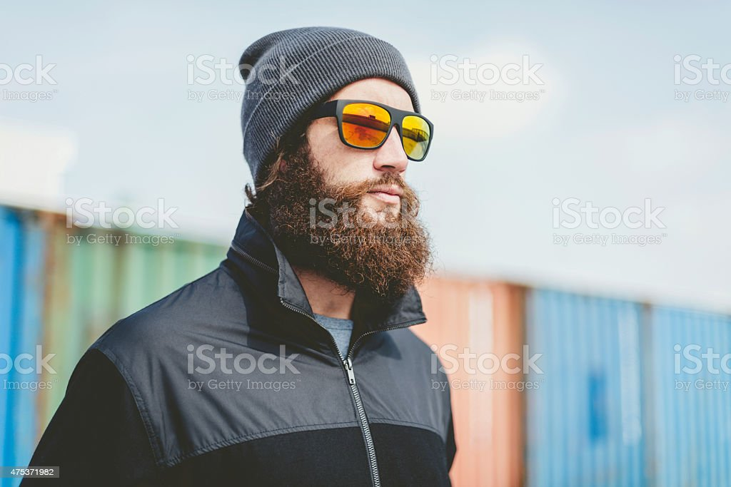 Serious Man with Long Beard Looking to Far Right stock photo